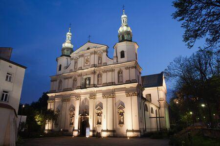historical landmark: Bernandine Church at night in Krakow, Poland, 17th century Baroque architecture. Stock Photo