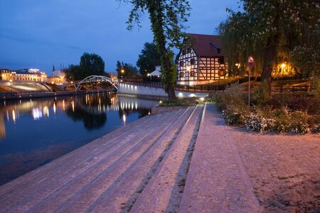 granary: City of Bydgoszcz by night in Poland, Brda river waterfront on Mill Island and White Granary.