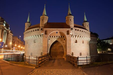 fortification: Barbican by night in Krakow, Poland. 15th century fortress, part of the old city wall fortification.