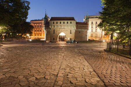 outpost: Barbican by night in Krakow, Poland. 15th century old city wall fortification. Editorial