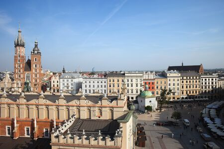 tenement: City of Krakow in Poland, Main Market Square in the Old Town with Cloth Hall (Sukiennice), historic tenement houses and St. Mary Church on the left.