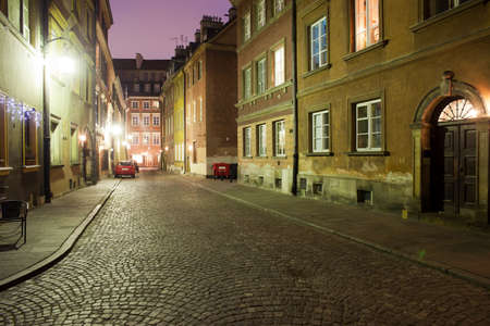 tenement: Poland, , Old Town by night, Krzywe Kolo street and historic tenement houses