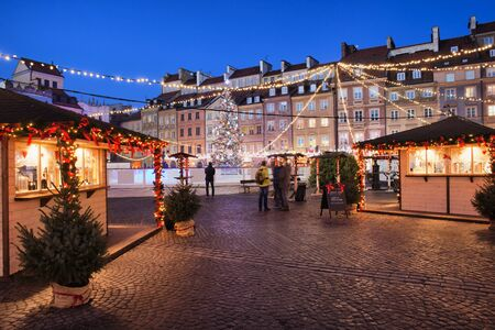 exterior shape: Poland, Warsaw, Old Town Square by night, Christmas decoration and illumination, historic city centre