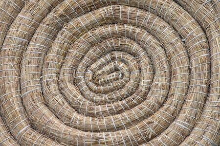 coiled: Closeup for background on traditional archery round coiled straw target Editorial