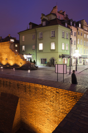 Poland, Warsaw, Old Town by night, city wall and tenement houses
