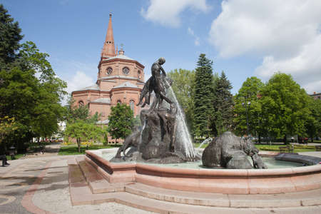 ferdinand: The Deluge Fountain in Kazimierz Wielki Park in Bydgoszcz, Poland, designed by Ferdinand Lepcke (1866-1909), erected in 1904, Church of St Peter and St Paul behind.