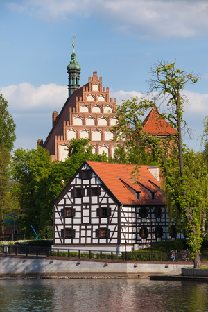 granary: City of Bydgoszcz in Poland, White Granary on Mill Island and Cathedral, river Brda waterfront. Editorial