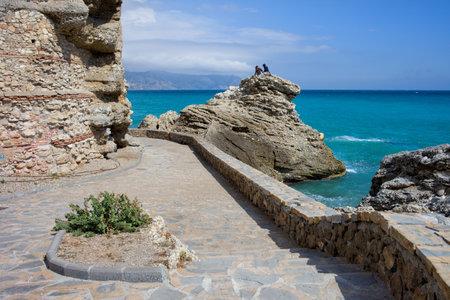 nerja: Promenade along the sea under Balcon de Europa in Nerja, resort town on Costa del Sol in Spain.