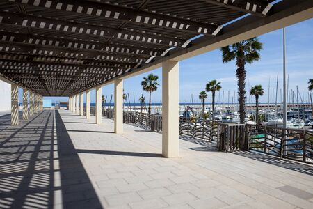 passageway: Pergola shaded passageway at Port Olympic in Barcelona, Catalonia, Spain. Editorial