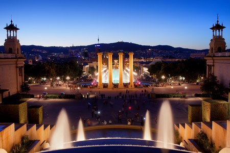 barcelona: City of Barcelona by night in Catalonia, Spain, view from Montjuic towards Magic Fountain and Four Columns.