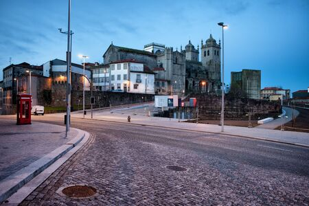 historic district: Morning in the city of Porto in Portugal, cathedral skyline and empty streets of historic district. Editorial