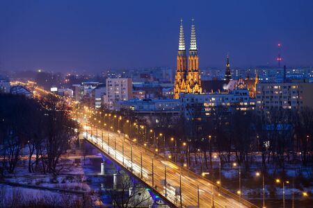 praga: Solidarity Avenue towards Praga district skyline in Warsaw, Poland by night