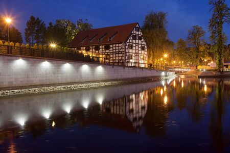 granary: City of Bydgoszcz in Poland, White Granary on Mill Island at night, river Brda waterfront. Editorial