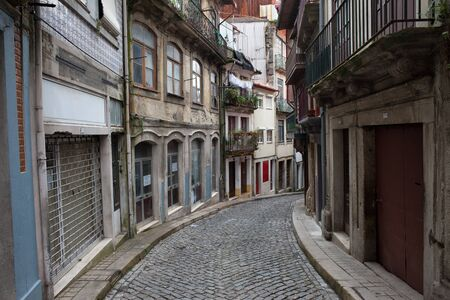 cobbled: City of Oporto in Portugal, cobbled, narrow street and houses in the Old Town.