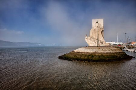 monument historical monument: Mist at the Monument to the Discoveries and Tagus river in Belem, Lisbon, Portugal.