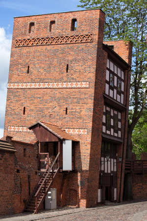 14th: The Leaning Tower in Torun, Poland, part of the medieval city wall fortification from 14th century.