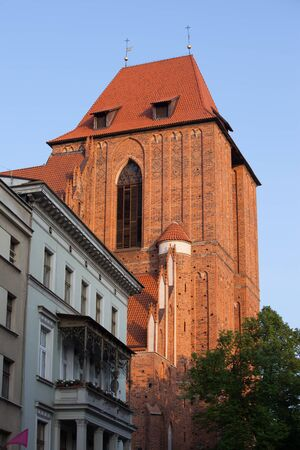 evangelist: Torun, Poland, sunset at Gothic Cathedral Basilica of St. John the Baptist and St. John the Evangelist.