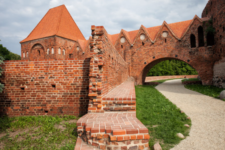 13th century: Teutonic Knights Castle in Torun, Poland, historic city landmark dating back to 13th century.