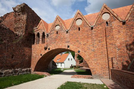 13th century: Teutonic Knights Castle gate in Torun, Poland, city landmark dating back to 13th century.