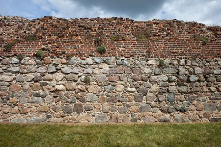 fortify: Teutonic Knights Castle wall background in Torun, Poland, stone and brick medieval fortification.