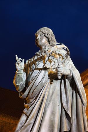 erected: Nicolaus Copernicus monument in Torun, Poland at night, city landmark erected in 1853. Stock Photo