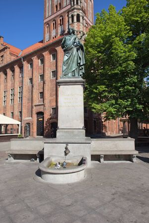 copernicus: City of Torun in Poland, Nicolaus Copernicus monument erected in 1853 in the Old Town Market Square. Stock Photo