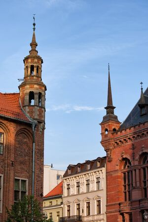 turrets: Corner turrets with spires of the Town Hall and Artus Court, historic architecture in the Old Town of Torun, Poland. Stock Photo