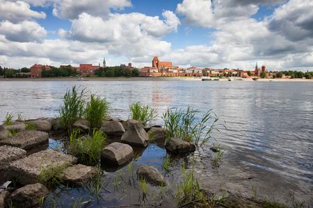 torun: City of Torun skyline in Poland from Vistula (Wisla) river bank. Stock Photo