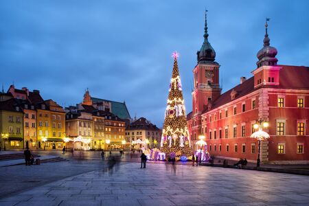 illuminations: City of Warsaw in Poland by night, Old Town, Royal Castle, Christmas Tree and old tenement houses. Editorial