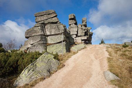 footway: Three piglets (Polish: Trzy Swinki) or Three Little Pigs granite rock formation in Karkonosze - Krkonose mountains, Sudetes, Silesia, Poland and Czech border.
