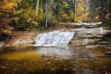 czech republic: Water cascade on Mumlava stream in autumn forest of Giant Mountains, Czech Republic.