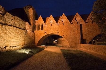 torun: Poland, Torun, Teutonic Knights Castle at night Editorial