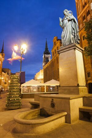 erected: Poland, Torun, Nicolaus Copernicus monument at night in Old Town, erected in 1853.