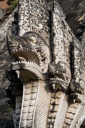 serpents: Naga serpents sculpture in Wat Chedi Luang Temple in Chiang Mai, Thailand. Stock Photo