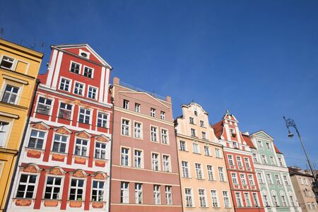 houses row: Row of historical tenement houses in the Old Town of Wroclaw in Poland. Stock Photo