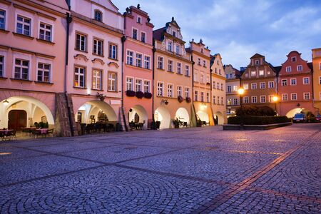gabled house: City of Jelenia Gora in Poland, Old Town Market Square with gabled historic houses with arcades in the evening, Lower Silesia Voivodeship.