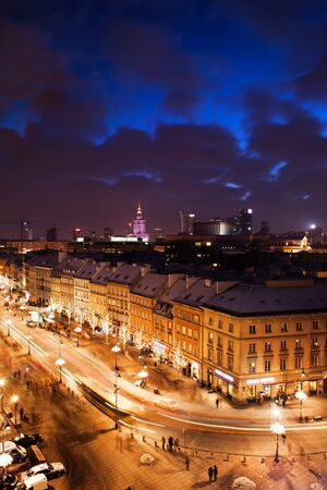 City of Warsaw in Poland by night, Krakowskie Przedmiescie street with historic tenement houses, view from above