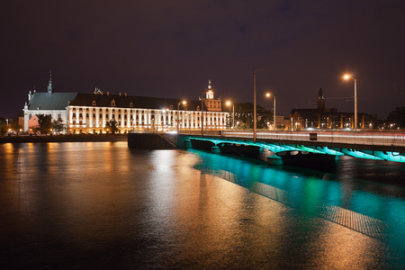university building: City of Wroclaw in Poland, Odra river, University building and bridge (Polish: Most Uniwersytecki) by night Stock Photo