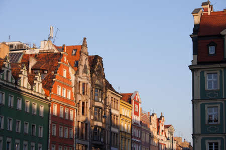 tenement: Poland, Wroclaw, Old Town, old tenement houses, apartment buildings in historic city centre at sunset