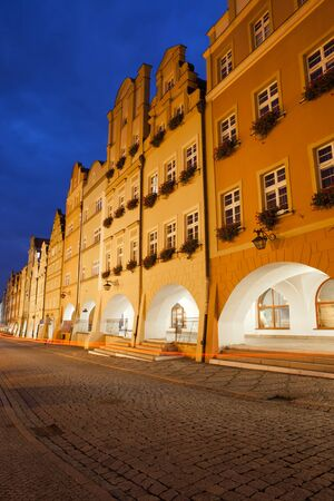 gabled house: City of Jelenia Gora by night in Poland, historic tenement houses with arcade and gables