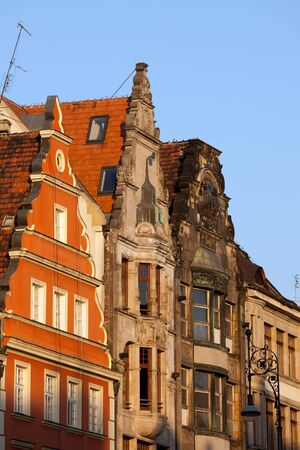 tenement: Historic tenement houses with gable at sunset, city of Wroclaw, Lower Silesia, Poland