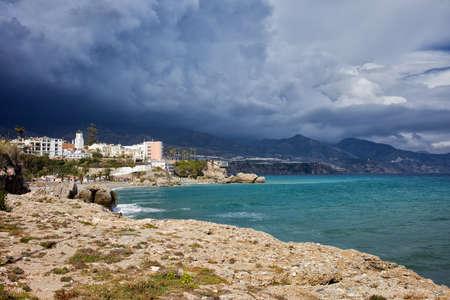 nerja: Stormy sky above coastline of Mediterranean Sea, Costa del Sol, Nerja, Spain Stock Photo