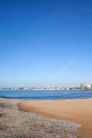 Portugal, Estoril and Cascais, beach partially covered with stones by the Atlantic Ocean, summer vacation scenery