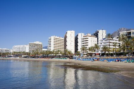 sea of houses: Beach skyline in resort city of Marbella, Costa del Sol, Spain, apartment houses, condominiums at Mediterranean Sea