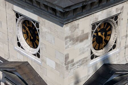 clocktower: Clocks with Roman Latin numbers on St Stephen Basilica bell tower, clocktower in Budapest, Hungary, closeup, architectural detail