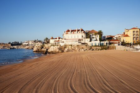 combed: Portugal, resort town of Casccais, sunny beach by the Atlantic Ocean in the morning, vacation scenery