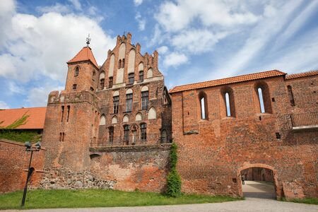 fortify: Citizen Court, sentry tower and city wall in Torun, Poland, former summer residence of the Brotherhood of St. George, medieval Gothic architecture from 13-15th century. Editorial