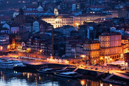 cramped: Portugal, city of Porto by night, medieval Old Town by Douro River
