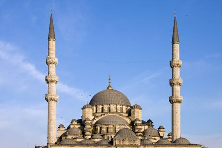 cami: Turkey, Istanbul, New Mosque (Turkish: Yeni Valide Cami) domes and minarets, Ottoman imperial mosque. Stock Photo