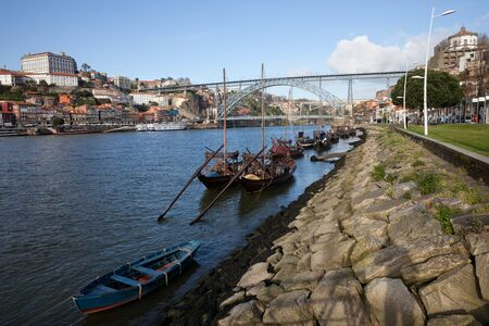 rabelo: Portugal, Porto, Vila Nova de Gaia, Rabelo traditional boats for wine transport on Douro river, Dom Luis I Bridge Stock Photo